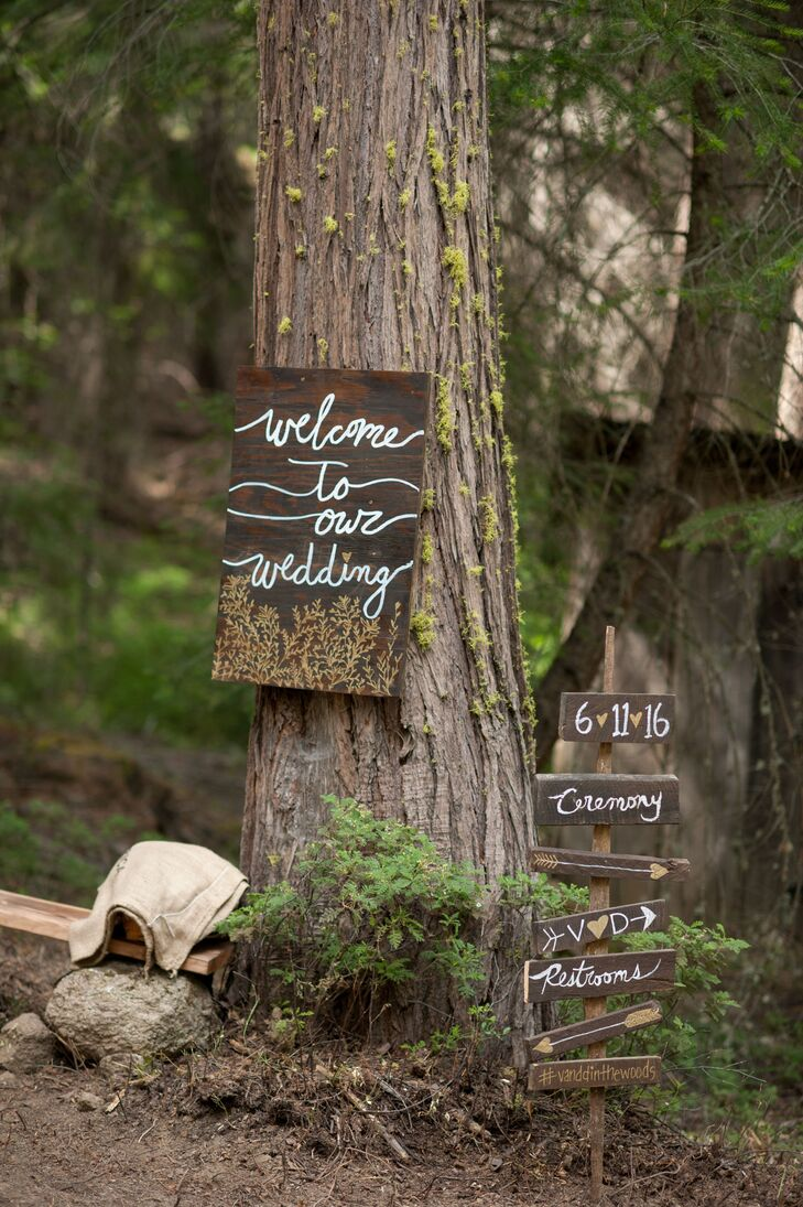 These handcrafted signs led guests to the ceremony site and nearby reception in Grizzly Flats, California.