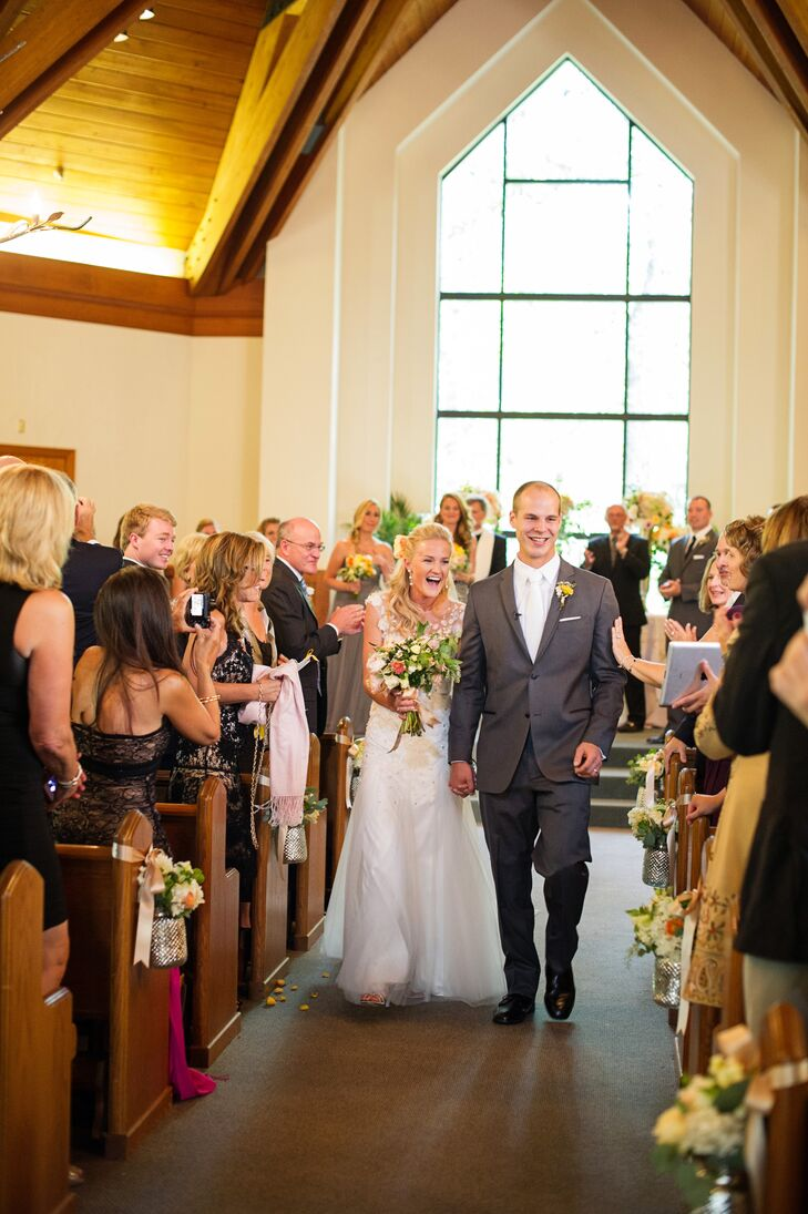 Liz wore a Christos by Amsale A-line wedding dress with crystal and lace detailing and an open back.