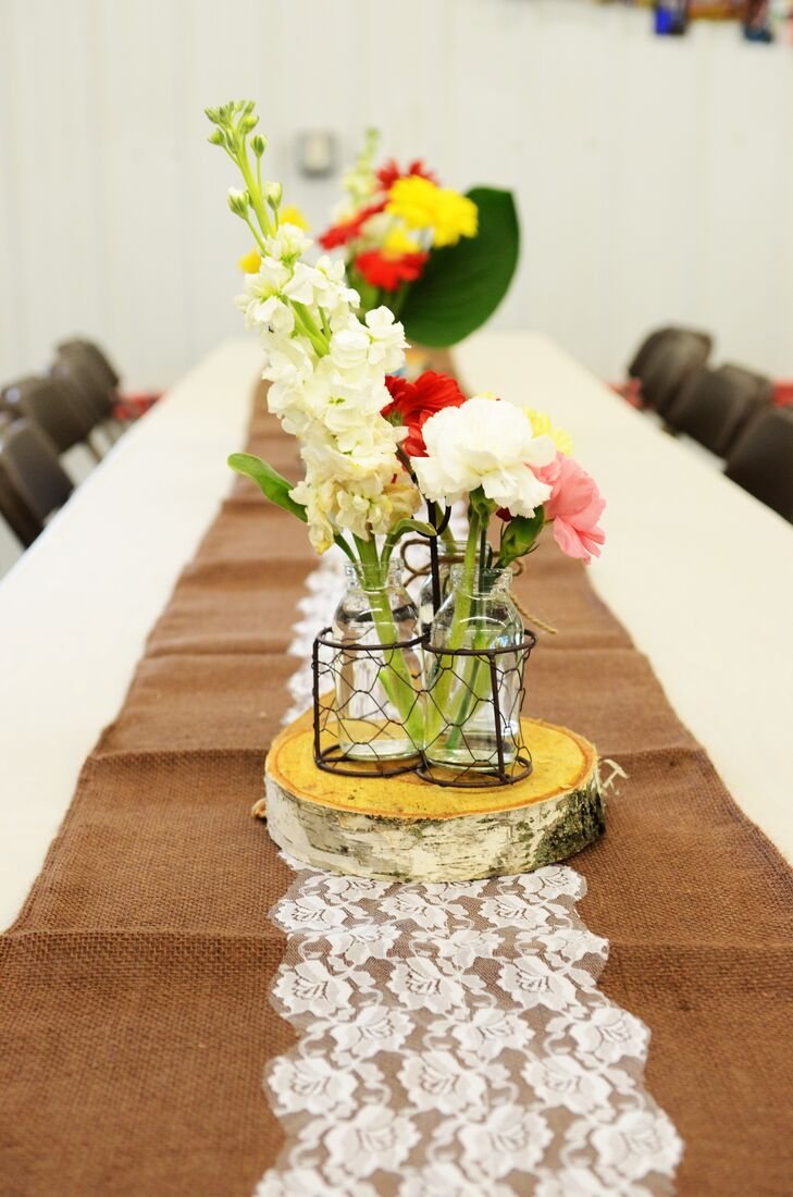 Rustic burlap and lace runners lined the length of each reception table in Cushing, Wisconsin.