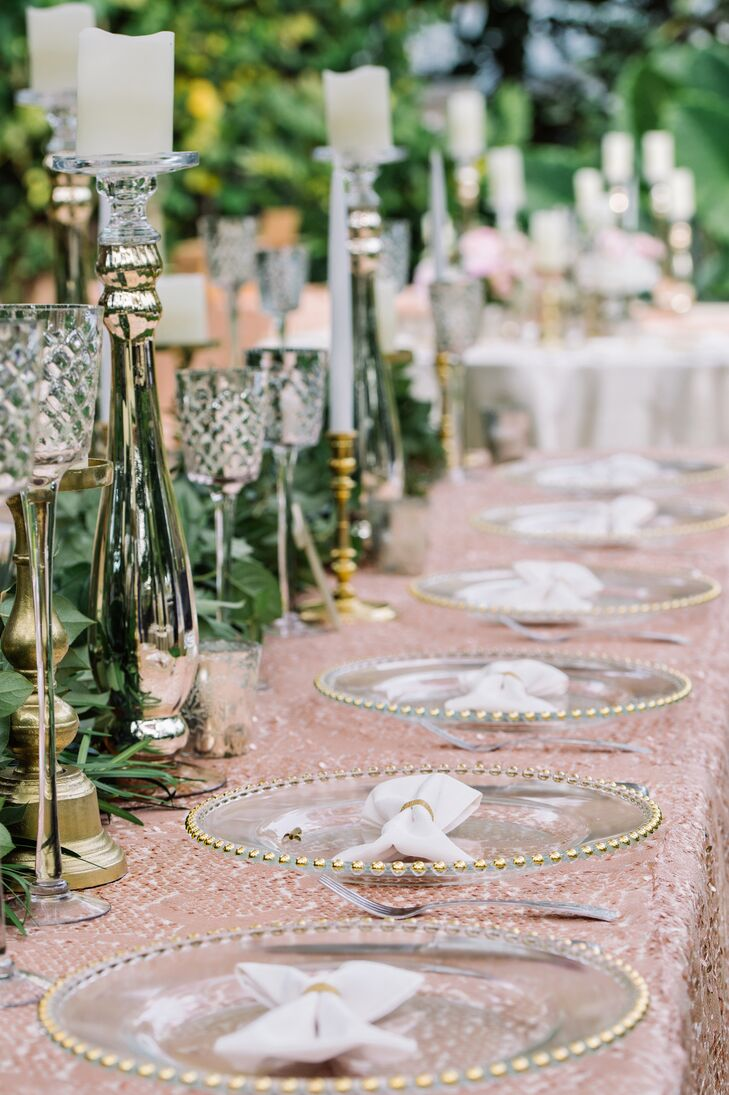 A pink sequined linen spiced up the head table while the other tables wore champagne-colored linens.
