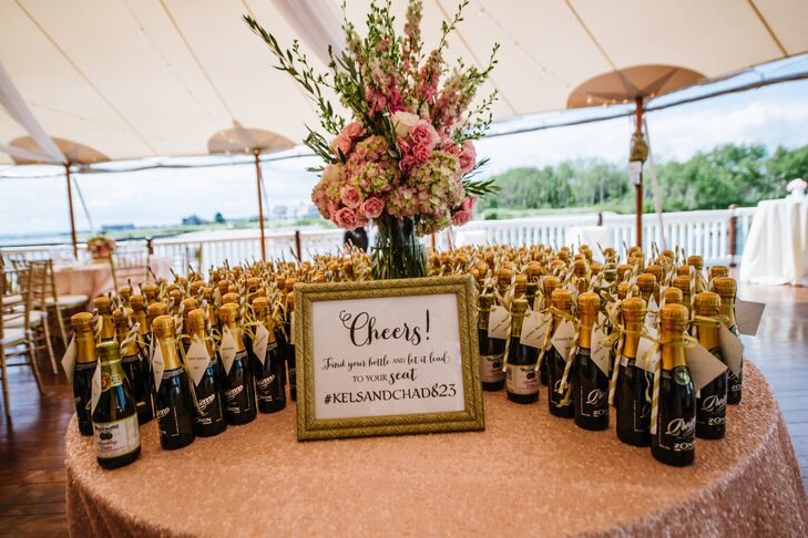 The fun escort cards were attached to champagne bottles.