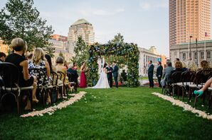 Vows Under Floral Arch at Urban Ceremony