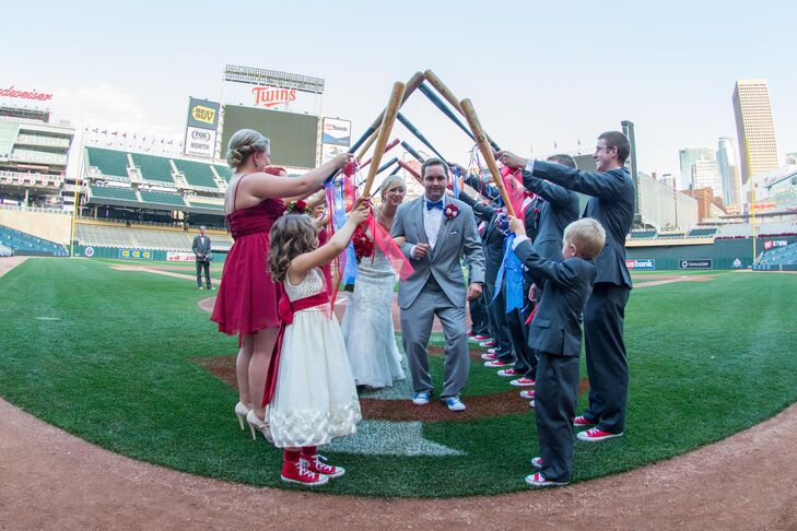 The couple exited their ceremony underneath a baseball bat saber arch.