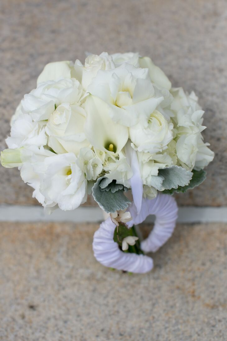 Rather than using flowers throughout the reception, the bride chose only to utilize the calla lilies in her bouquet -- leaving a larger portion of her budget to go toward the band and food.