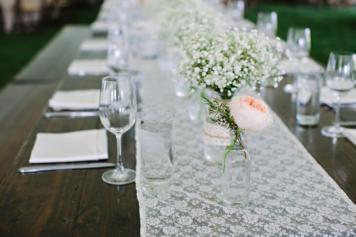 Lace runners topped with gold mercury votives and baby's breath arrangements gave a homey feel to the long farm tables.