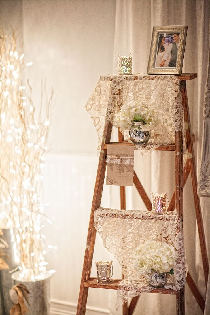 """""""I was able to get a hold of an old wooden ladder that belonged to my grandfather in the 1950s, draped lace on the steps and placed it in the entryway to the ceremony,"""" says Jessica."""