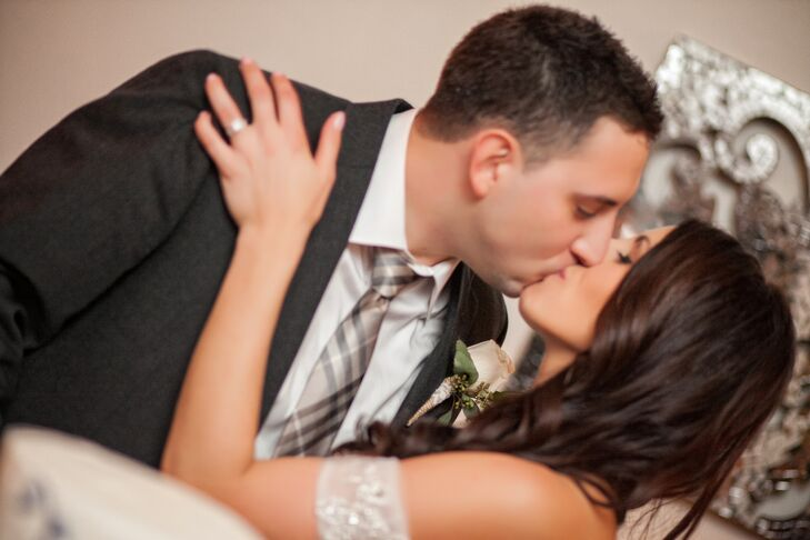 Newlyweds Kiss After Sharing Their Wedding Cake