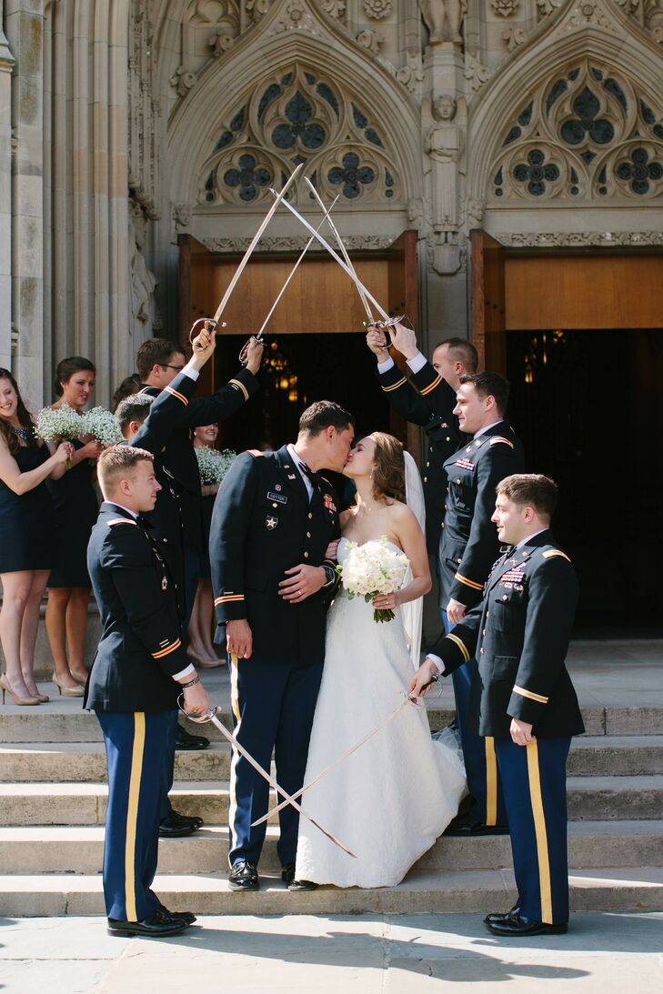 After the ceremony, guests lined up on the steps of the chapel for a traditional saber arch military exit. All active duty members of the military lined up with there sabers and Sarah was welcomed to the Army with pat on her backside.