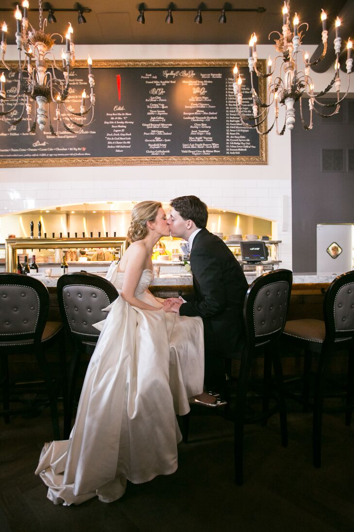 Taylor and Leigh share a quick kiss for their post-ceremony wedding photos.