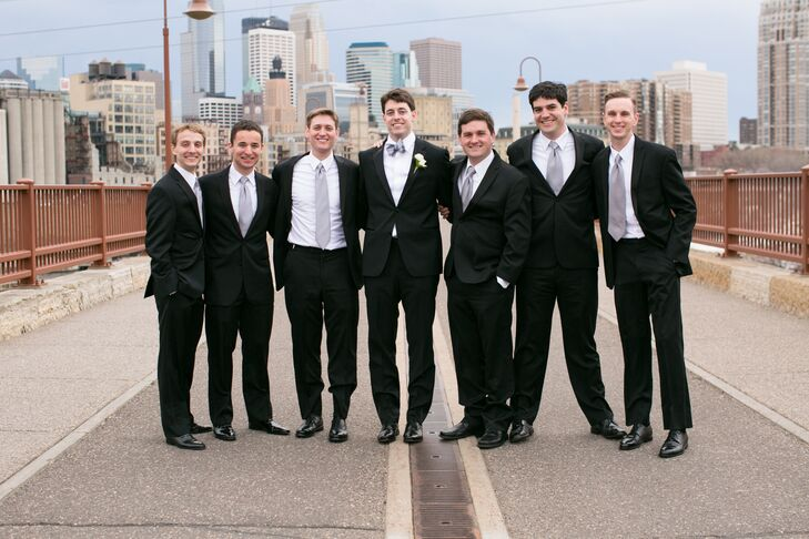 Leigh chose a black Hugo Boss tux with a silver bow tie while the groomsmen donned similar black Calvin Klein tuxes.