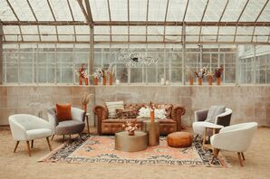 Lounge Area with Leather Couch and Copper-Hued Accents