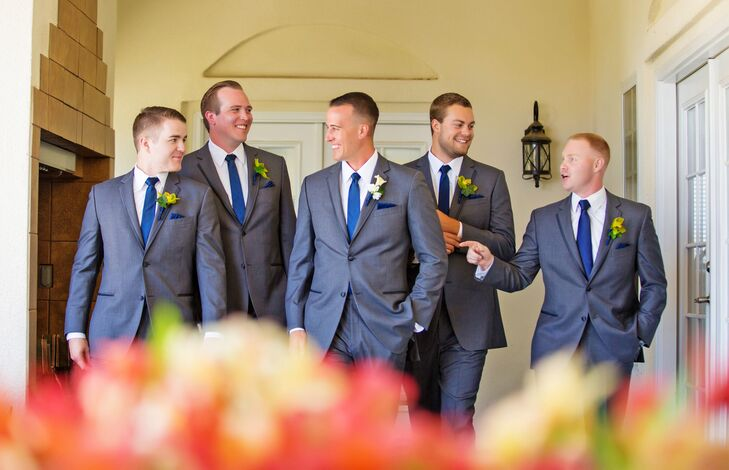 Ashley wanted the groomsmen to be clean and simple, so she preferred dark gray over black for a summer outdoor wedding.