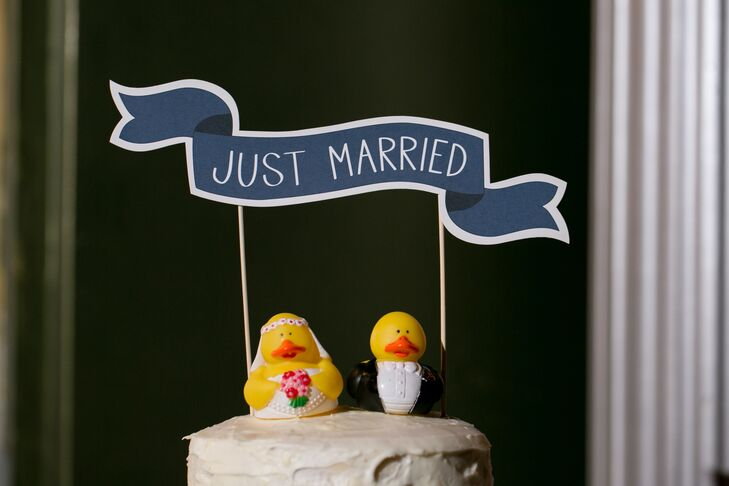 Quirky cake toppers added a fun touch to the couple's homemade wedding cake.
