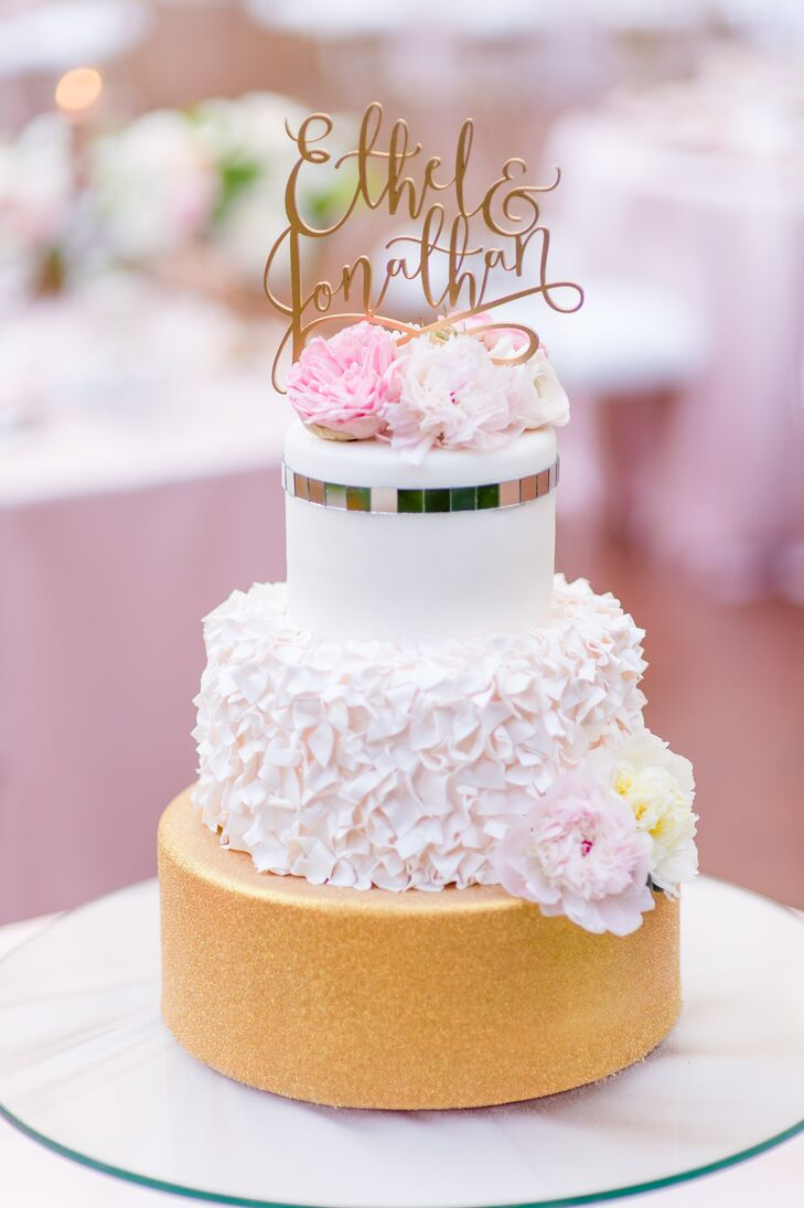 The Four Seasons created Ethel and Jonathan's gold and pink cake, which was decorated with frosted petals and fresh blossoms.