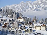 Snowy mountains and homes in Switzerland, Europe