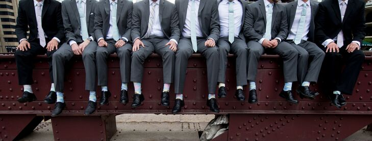 Brett and his groomsmen accessorized their charcoal gray Pronto Uomo suits with mint green ties from the Tie Bar, pastel socks and custom monogrammed tie clips.