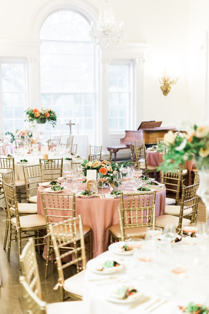After the ceremony, the drawing room was converted to seating for the Southern-infused dinner. Peach table linens, gold chiavari chairs and alternating centerpieces gave the room a romantic, elegant feel.