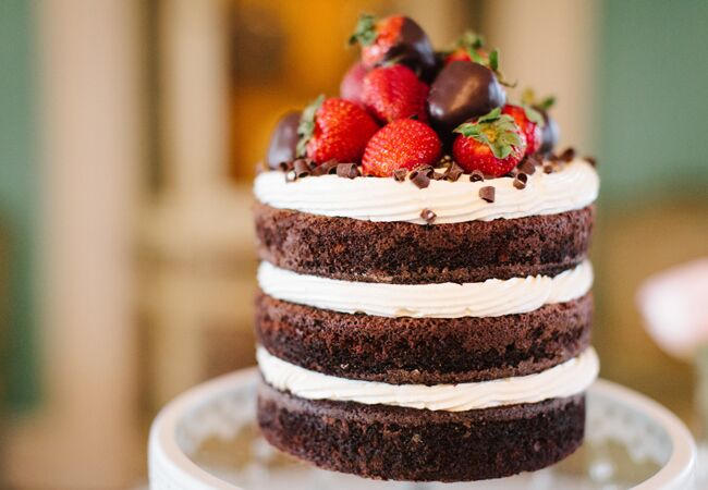Chocolate naked cake with strawberries on top