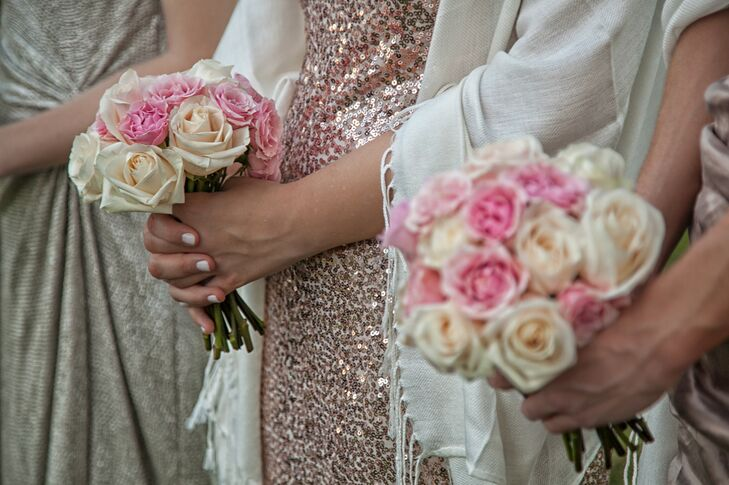 The bridesmaids carried bouquets of pink and ivory roses crafted by J Morgan Flowers.