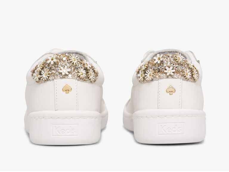 White wedding sneakers with gold glitter and daisy details on the heel