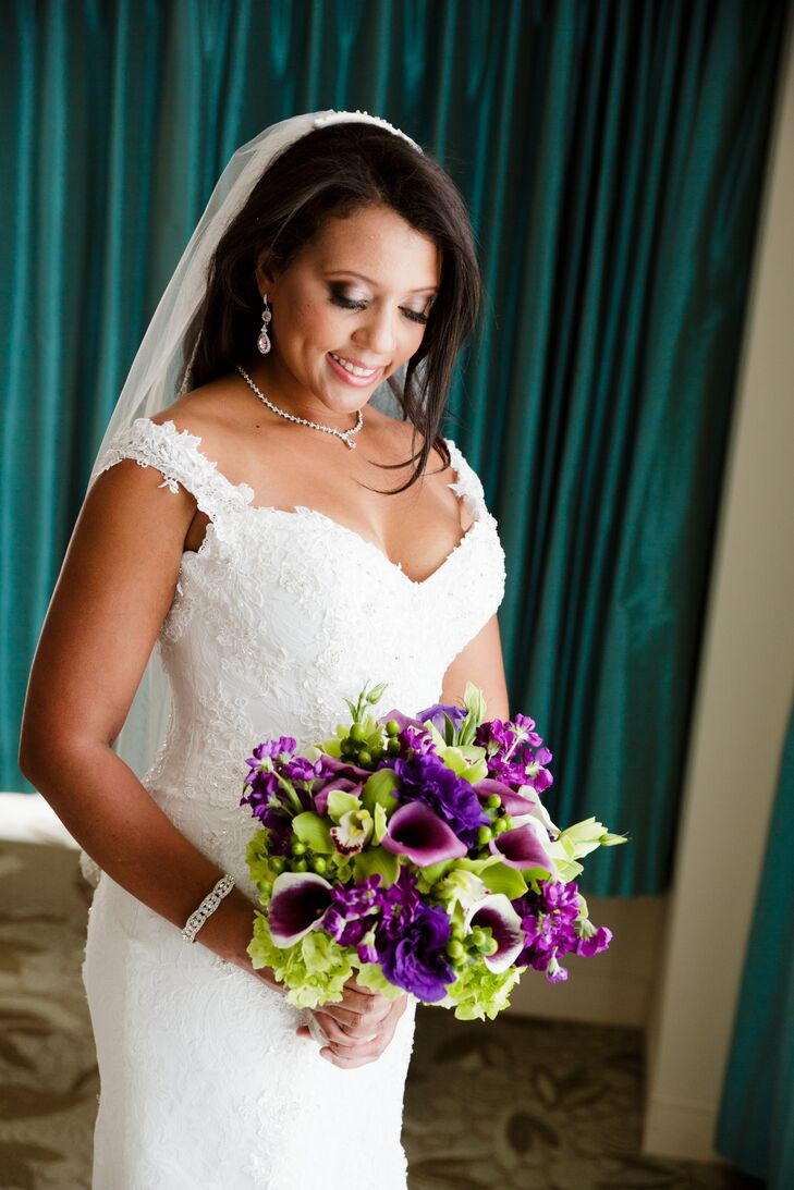 Marzetta walked down the aisle with an eye-catching bouquet arranged by Lee Forest Design. It was composed of purple calla lilies, green hydrangea, purple peonies, green orchids, green hypericum berries and purple delphiniums.