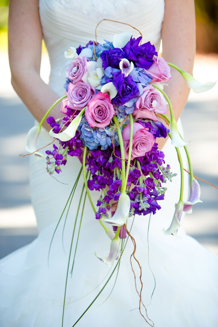 Lauren carried a cascading bouquet of white calla lilies, pink roses, blue hydrangea, purple roses and white narcissus.