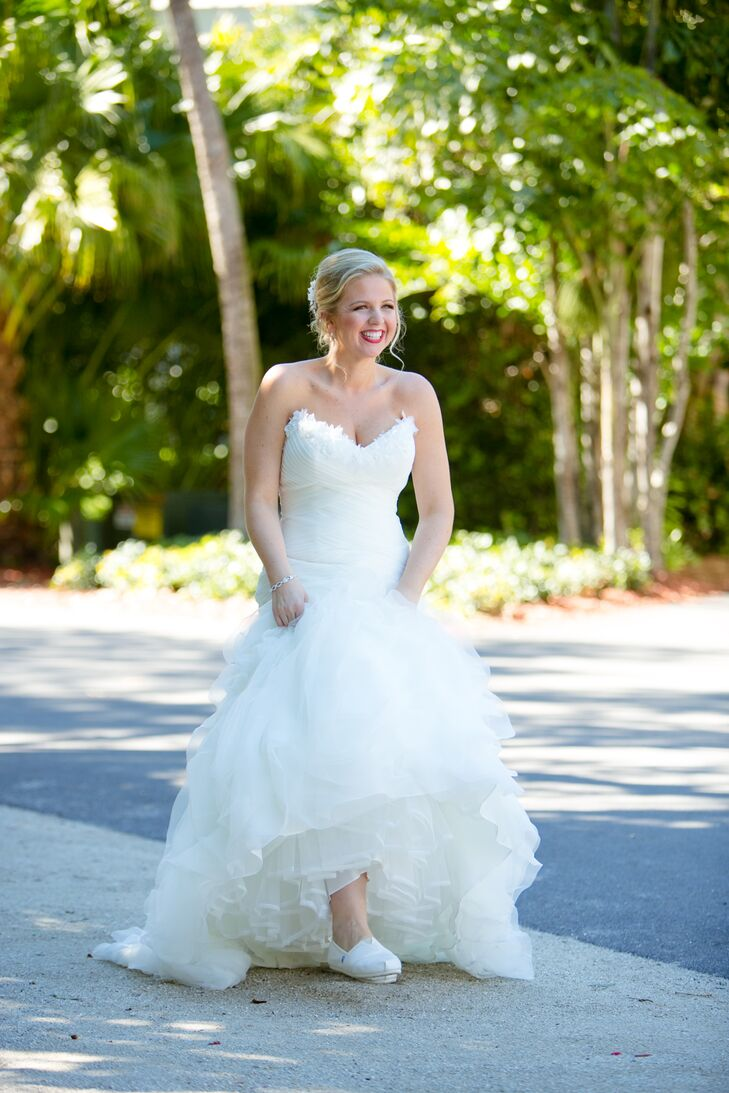 """Lauren chose a white strapless mermaid Pronovias wedding dress with floral details along the neckline. It """"flowed perfectly while walking along the beach,"""" she says."""