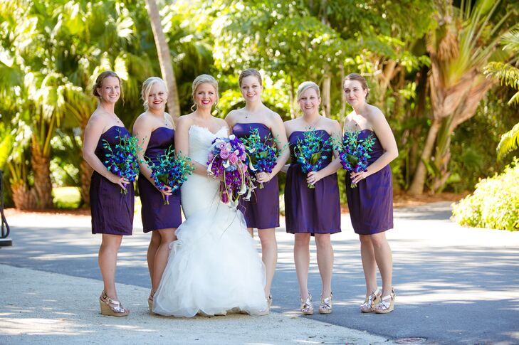 The bridesmaids wore strapless royal purple cocktail dresses with neutral wedges and simple jewelry.