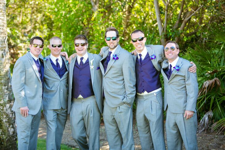 The groomsmen were dressed in light gray suits with purple vests, purple ties and purple orchid boutonnieres.