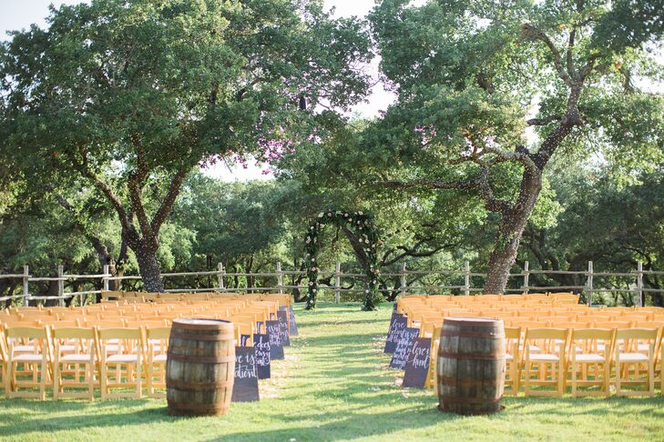 Two wine barrels marked the entrance, petals lined the aisle and handwritten signs featured words from 1 Corinthians 13:4-8.
