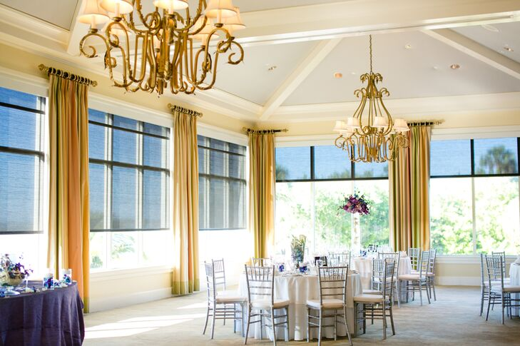 The couple decorated their reception with silver chiavari chairs, white linens as well as a mixture of colorful tall and low floral centerpieces.  It was held in the country club's ballroom overlooking the beach.