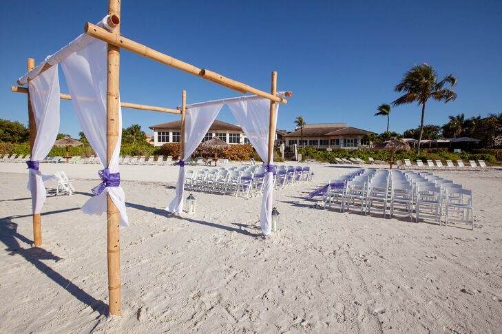 Lauren and Matt decorated their ceremony with a bamboo arch, white draped fabric and sheer purple fabric tied to chairs along the aisle.