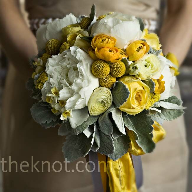 Ribbons and streamers added extra punch to peonies, ranunculus, yarrow, craspedia, roses, and dusty miller.