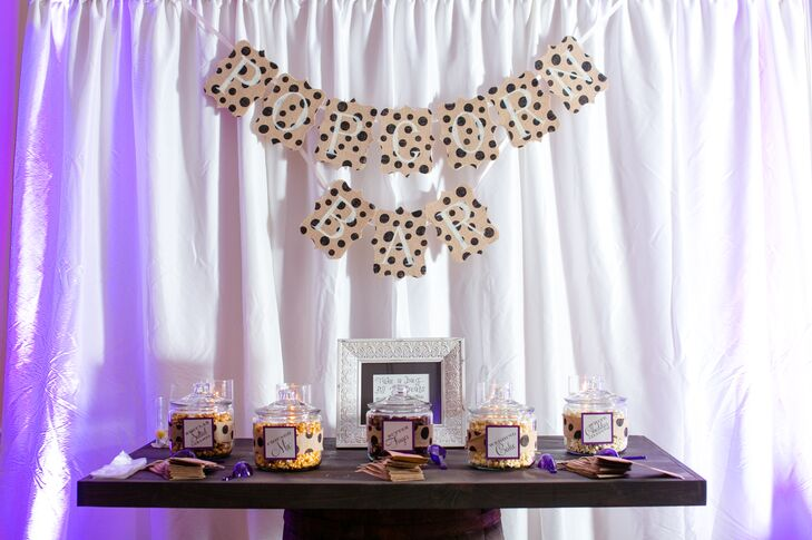 The couple had a popcorn bar at their wedding to recognize Lauren's home state of Texas, she says. The table base was made from a barrel for a rustic accent.