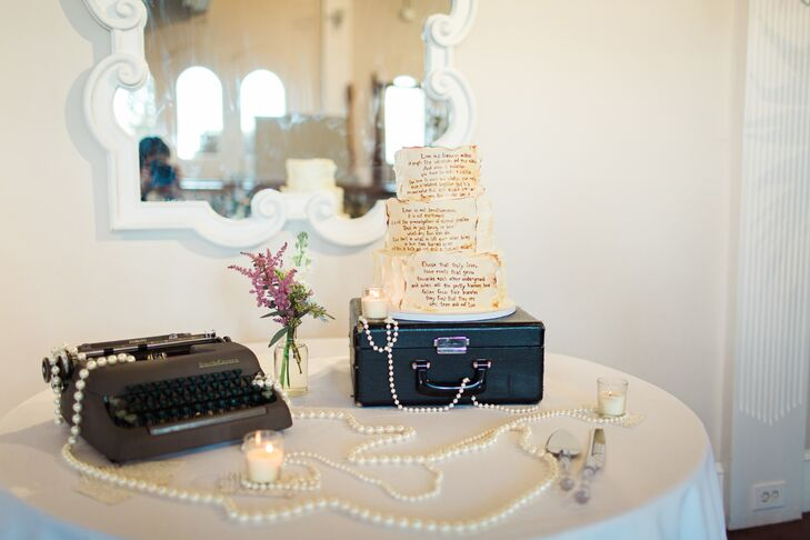 Small Town Cake Shop completed the couple's understated vintage theme with a three-tier ivory wedding cake accented with antique-style book pages.