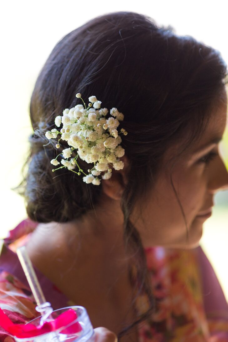 The bridesmaids wore their hair in updos accented with baby's breath.