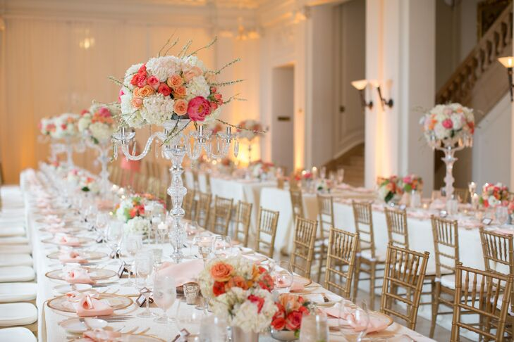 """Our dinner was held in a hall where we had long tables decorated with candles, crystal candelabras with flowers and other various vases of flowers,"" Sahar says. These tall crystal candelabras held up lush pastel-colored arrangements of hydrangeas, roses and peonies that were seen in the lower centerpieces as well."