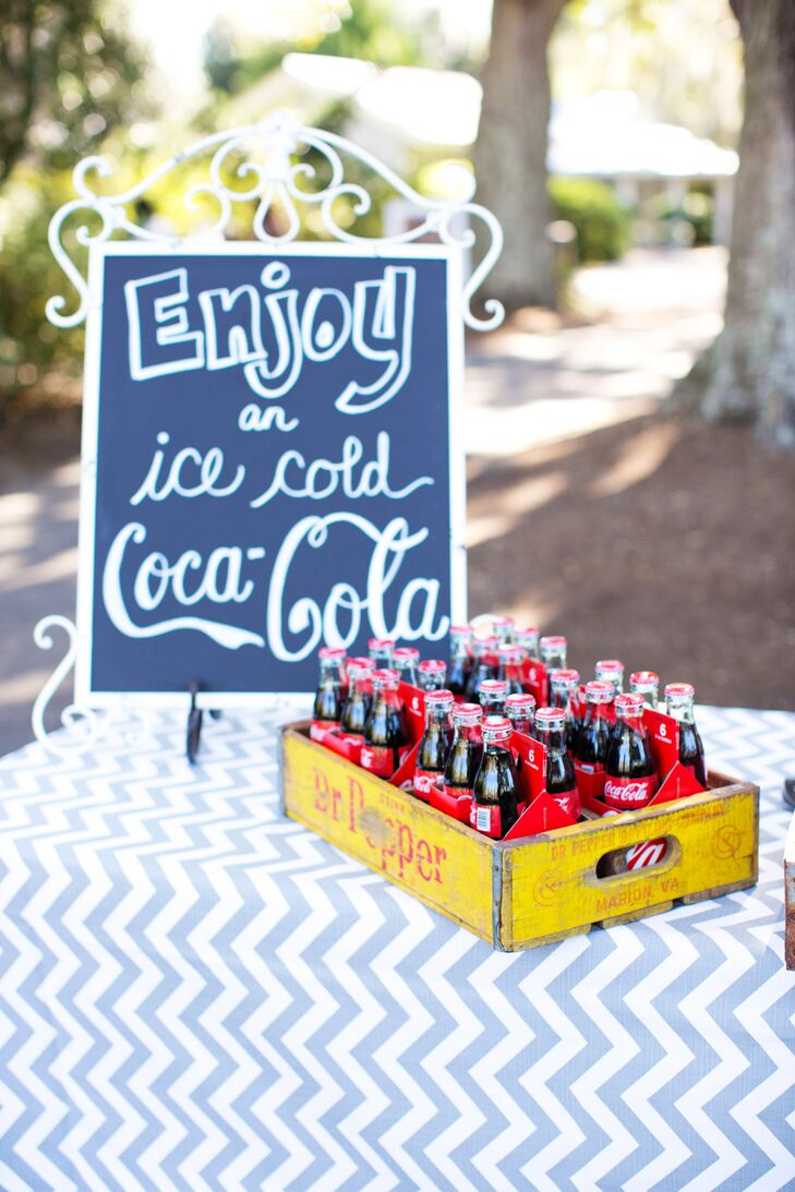Amalie and Jason had a Coca-Cola stand as guest entered the ceremony venue, offering a glass bottled coke with a paper straw.