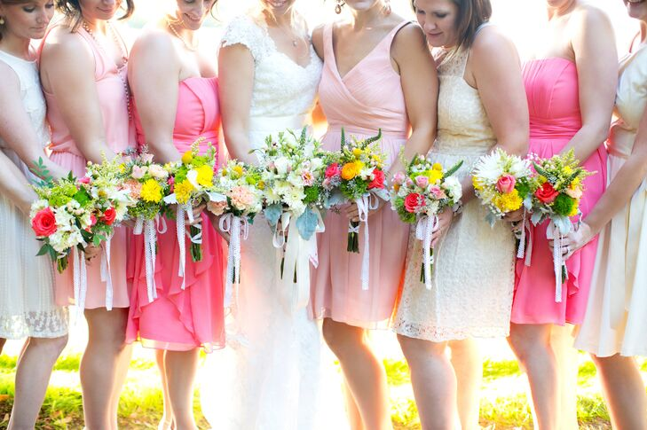 """The bridesmaids put together their own bouquets after the bridesmaid's luncheon.  """"My mom, our  florist, had tons of flowers in buckets and the girls selected and arranged the flowers they wanted to include,"""" says Amalie. """"My mom and her talented friends helped the girls secure their bouquets and tie the stems with raffia."""""""