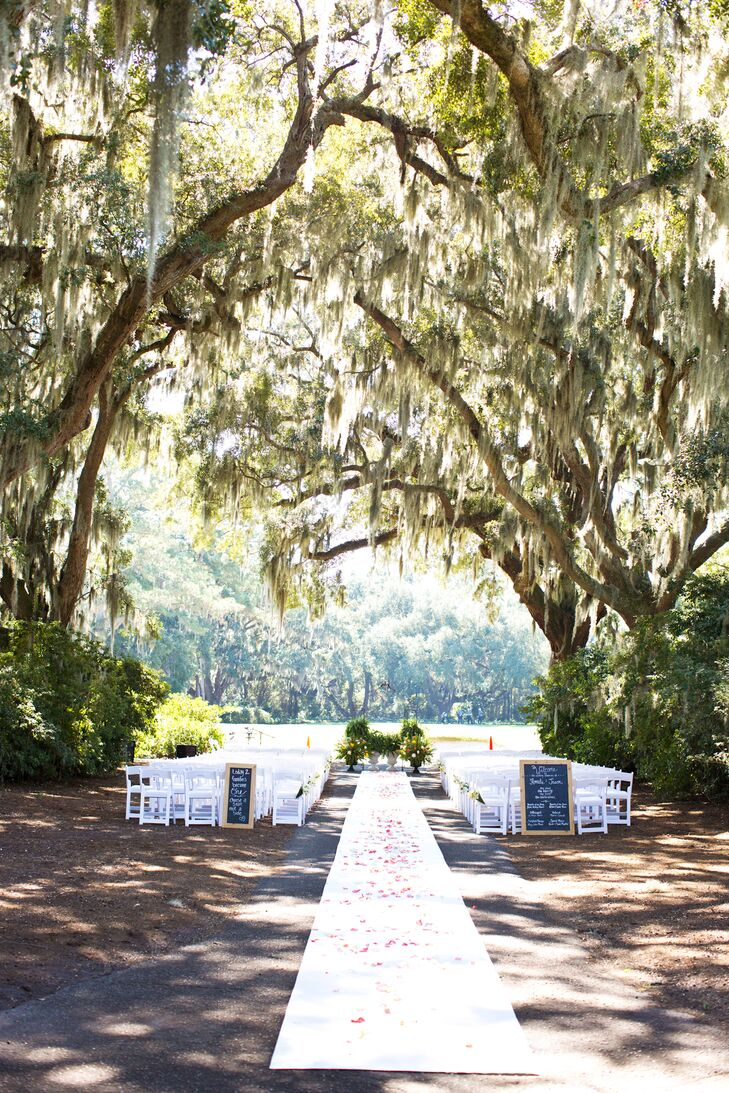 """The ceremony took place in a space that Caledonia calls Azalea Row under a """"hallway"""" of live oak trees with Spanish moss hanging down."""
