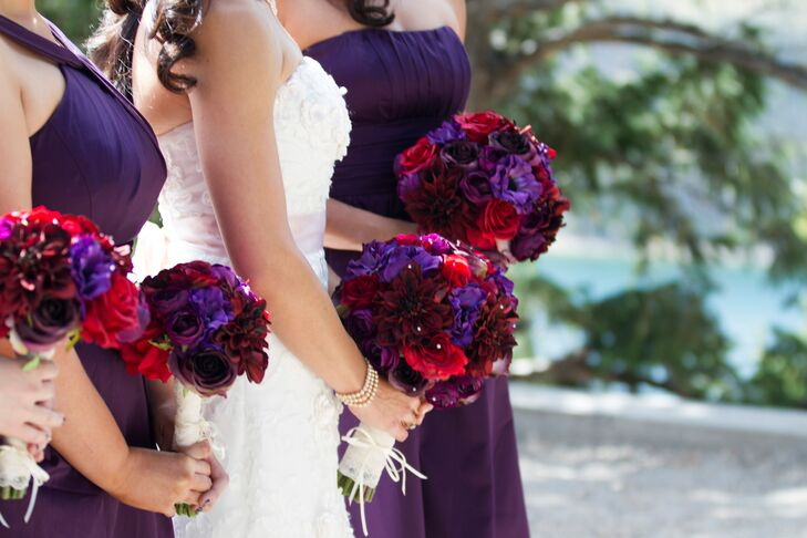 Gabrielle and her bridesmaids carried matching bouquets of vibrant purple, pink and burgundy flowers like roses, mums, dahlias and ranunculuses.