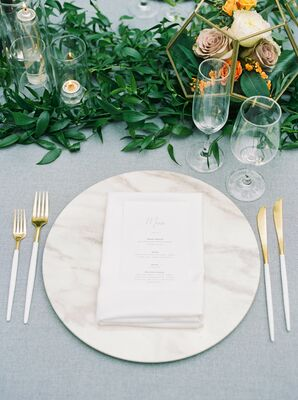Elegant Place Setting with Menu, Gold Flatware and Marble Charger
