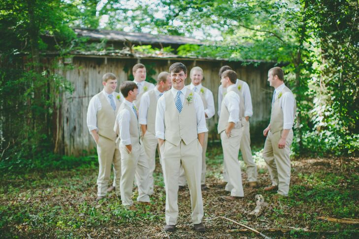 The groomsmen wore tan tuxes without  jackets, with gingham ties that inspired the navy color palette. rn