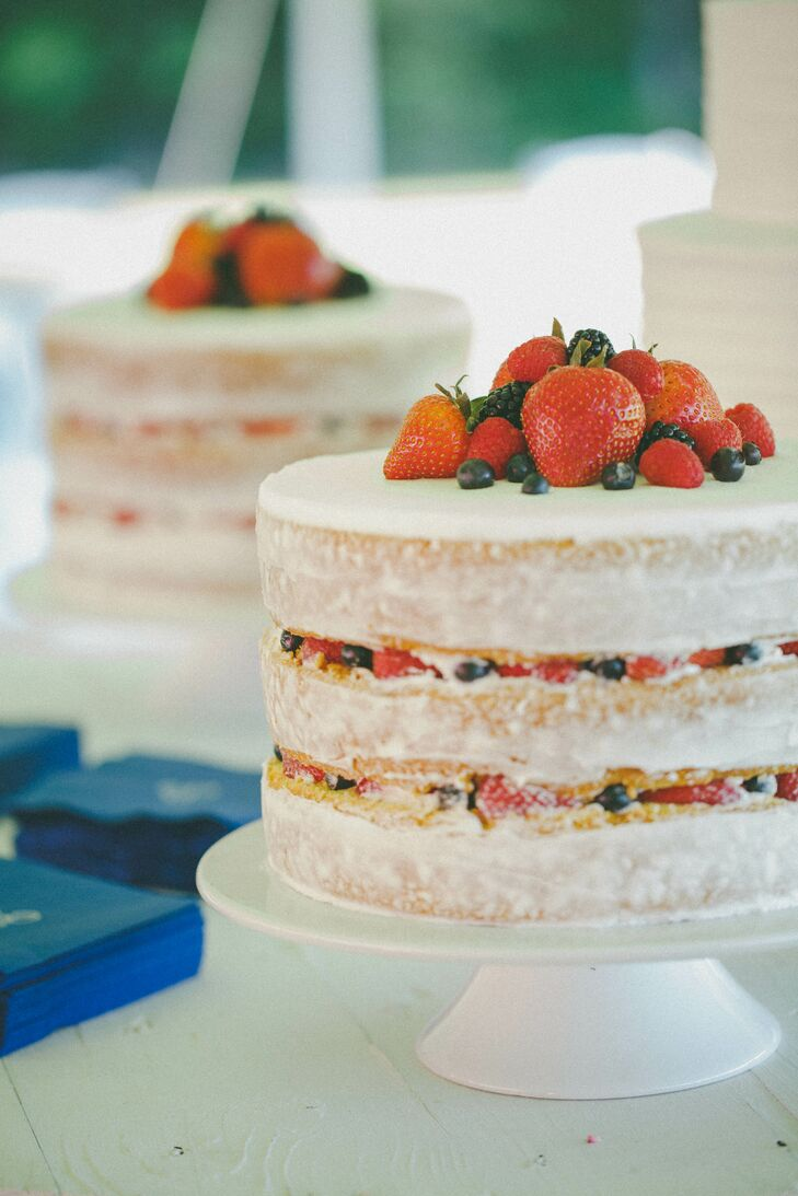 "Along with a tiered buttercream cake, the newlyweds served two satellite strawberry shortcake cakes topped with fresh berries. ""We wanted to add in little personal touches like berries on our satellite cakes and our ""Berry"" lemonade since our married last name is Berry!"" says Jenna."