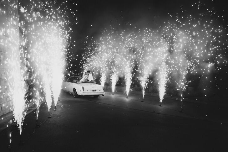 "At the end of the night, Kelly and Walt hopped onto the back of a 1979 Rolls-Royce convertible and waved good-bye as they drove through a tunnel of fireworks. ""Talk about sparks flying—it was gorgeous and lit up the sky for our final surprise,"" Kelly says."