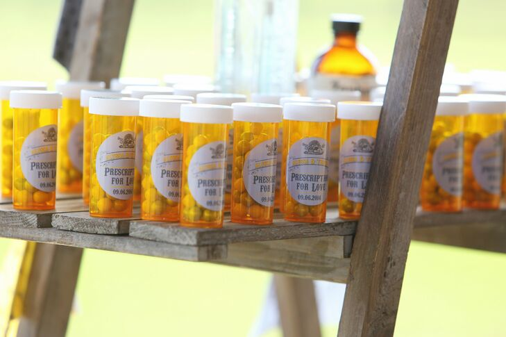 In honor of their vintage pharmacy theme, guests were gifted with prescription love medicine bottles filled with yellow and gray candies.