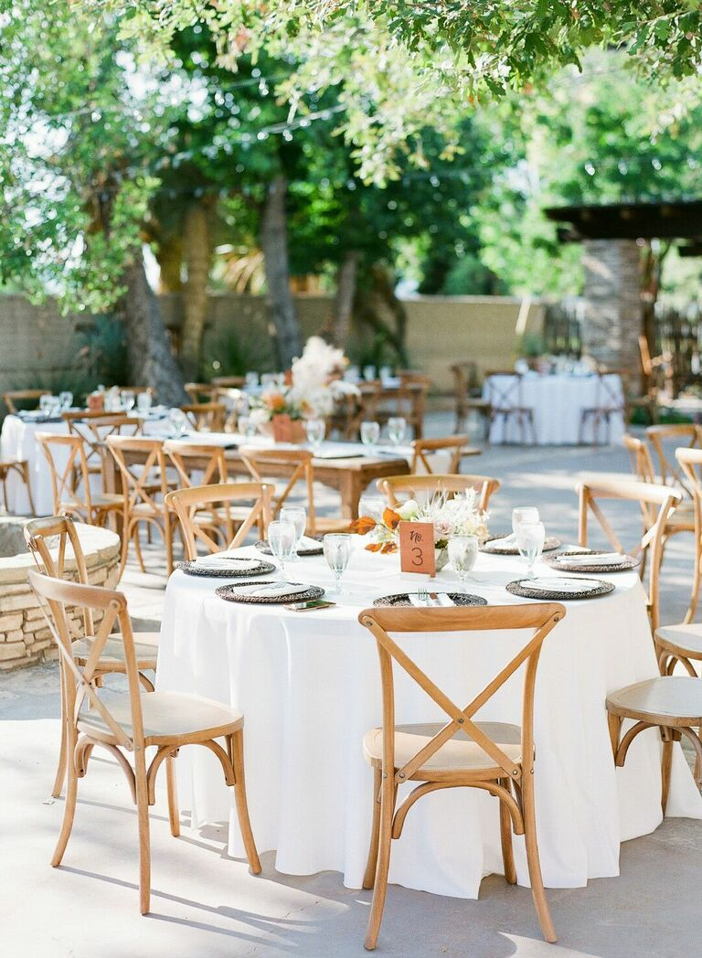 Rustic wedding reception decor with cross-back chairs