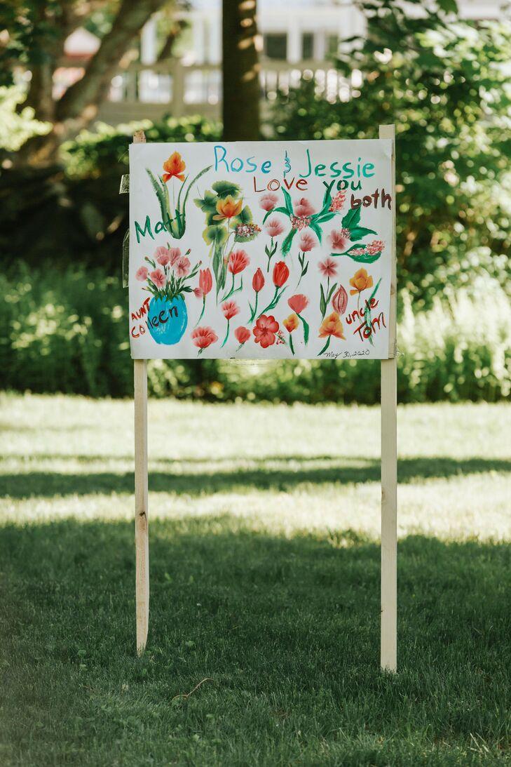 Hand-Painted Flower Sign for Backyard Minimony in Reading, Massachusetts