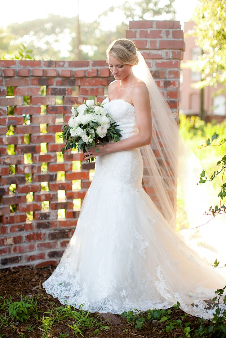 Christi knew she had to have a cathedral-length veil to complete her look, because she wanted the dramatic sophistication created by the veil for her wedding day outfit.