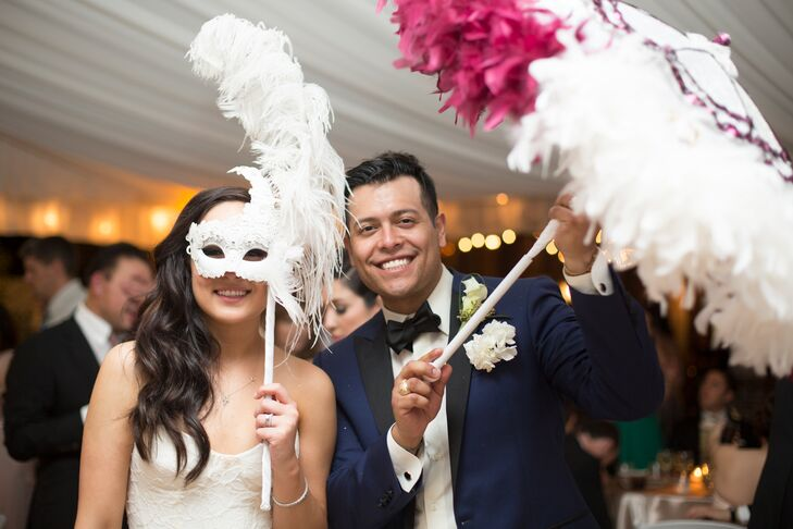 Mardi Gras masks were party props for Alexandra and Thomas, as they led a dance line around the venue. Their reception was a real party—just the way they wanted.